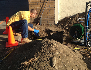 Todd is working on a sewer line repair